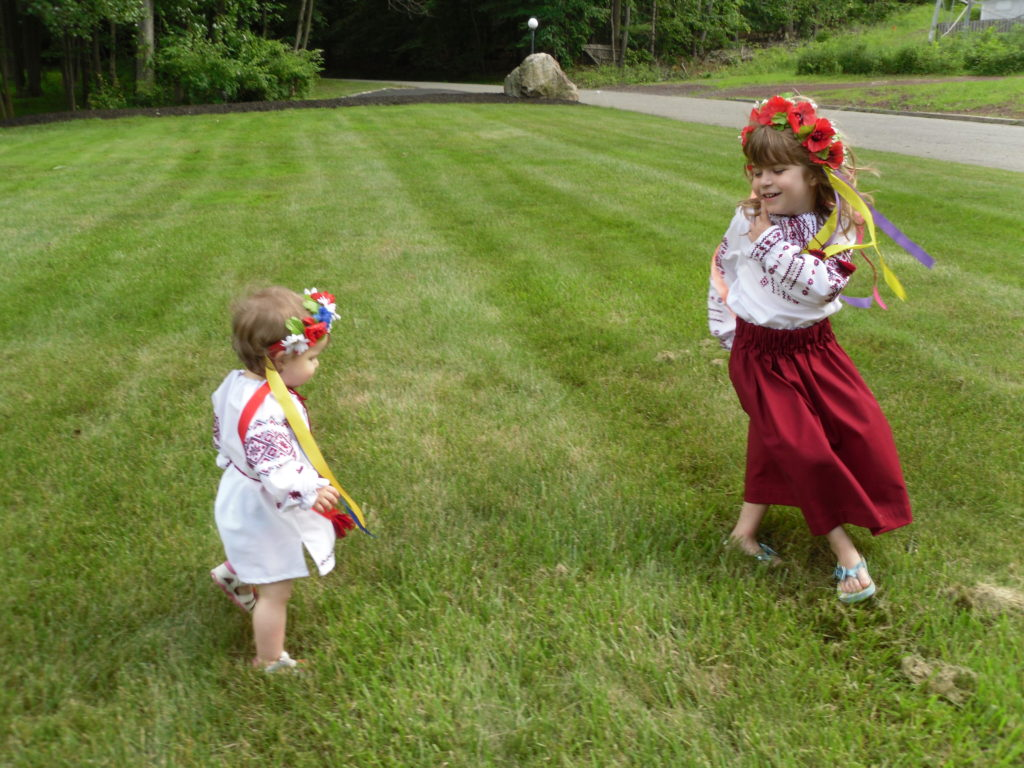 Remembering our Ukrainian roots, granddaughters Maggie and Anna are dancing on the lawn